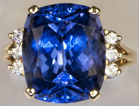 Previously owned Tanzanite diamond 14K ring. .