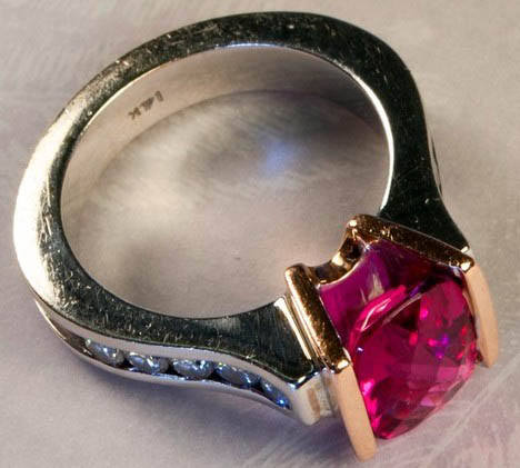 Previously owned Tourmaline diamond 14K ring.