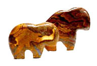 Ironstone Fetish Buffalo with an infinite variety of woodgrain swirls, patterns, tone, and texture. Some will show minute colorful Australian Boulder Opal veining. Buffalo fetish Approx. dimensions: 2½ inches long x 2¼ inches - 2½