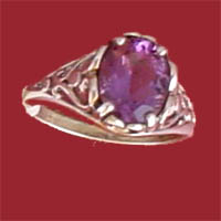 Item #121-RF-PFD- Exceptionally crafted sterling silver ring  features a genuine faceted amethyst 10x8 m.m. gemstone held by two sterling silver open worked hearts.