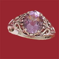 Item #121-RF-PNA-Am Sterling silver filigree design holds a prong set 10x8m.m faceted oval amethyst.