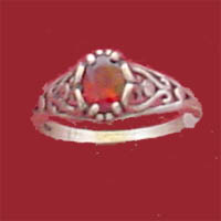 Item #RF-PNI, this ring is a stock item  available in a variety of stones, scale and prices.  As shown it features a 7x5m.m oval faceted garnet prong set in the center and framed by a sterling silver filigree heart design.  A high polished shank completes the look.