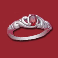 Item #RF-RIH-GA An oval faceted 5x3m.m. garnet is set into a delicate scrolled design of sterling silver.