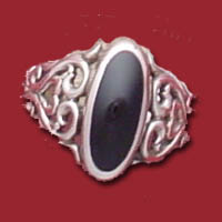 Item #121-CHR-FHF South western sterling silver inlaied Jet (fossil coal) filigree ring.  Very flat for a low profile yet measures over all 5/8 of an inch wide at the top of the ring (knuckle to knuckle).