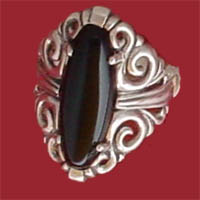 Item #121-RS-NRE-Ox  Artisan Crafted Sterling Bold enlongated 20x6m.m. Oval Cabachon Shaped Onyx Filigree Ring.