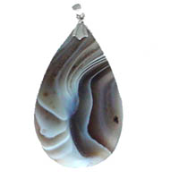 These pendants are beautifully hand-cut of natural Botswana agate, banded in striking colors of cream, brown, gray, black and white and suspended from a silver bail.  Made to be worn as a pendant on a silver chain, silk cord or ribbon.  In Stock  $6.00. Order NOW while supplies last!