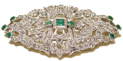 Classic, Lady's Art deco, Circa 1920, Diamond and Emerald 18K White Gold Pin/Broach in mint condition. This is not a commercial pin, this estate piece made of excellent craftsmanship contains 100 diamonds and 9 emeralds - estimated total gem weight 1 1/2 ct. and measures 1 3/4 x 7/8 inches. It is just begging to adorn a simple black dress. Available now $2,550.00!