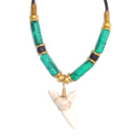 Present day mako shark tooth necklace strung on a 18 inch necklace(rubber cord), accented with turquoise patina ceramic beads.  Just $28.50.  Select from these trend setting styles plus many more original styles to choose from...